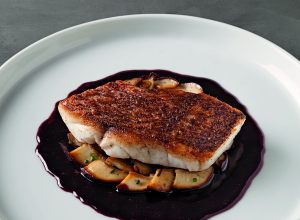 Red snapper and cepes in port reduction
