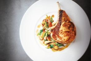 Milk-fed veal chops, tender young vegetables with spring garlic