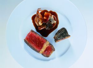 Thick Grilled Steak and Spiced Short Ribs with Chanterelles and Shallots