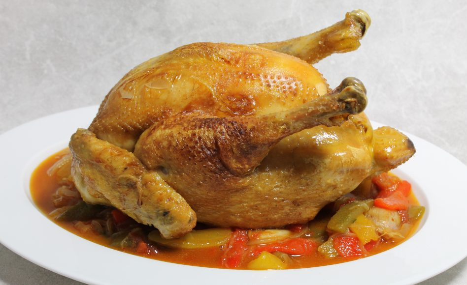 Pot roasted corn-fed landes chicken,  basquaise jus and garnish by Alain Ducasse