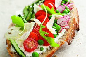 Tomato, peas, aspargus and radishes tartines