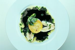 Hake with Squid Ink Sauce and Garlic Kokotxas