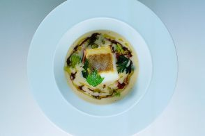 Chilled Cranberry Bean Consommé and Warm Bilbao Cod with Fried Lovage, Parsley and Celery Leaves