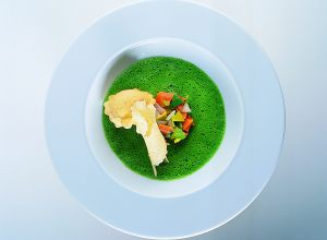Light Parsley and Watercress Consommé with Quail Egg Ravioli