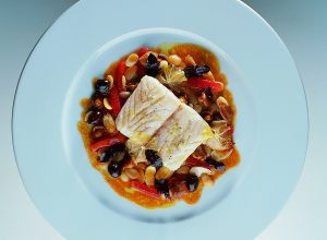 Griddled Mediterranean Sea Bass with White Pigna Beans, Fresh Almonds, Chanterelles and Tomato-Lemon Sauce