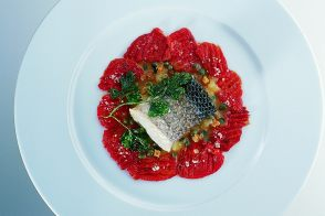 Roasted Mediterranean Bass with Confit Tomatoes and Grenobloise Sauce