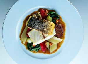 Fennel- and Roasted Garlic-Studded Mediterranean Sea Bass with Eggplant