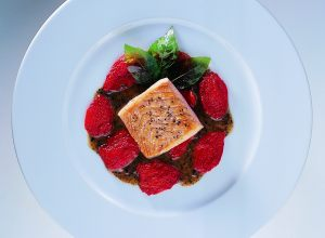 Wild Salmon with Crushed Truffles, Confit Tomatoes and Fried Basil